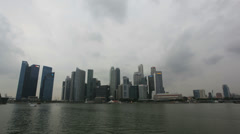 Singapore City Skyline with Fast Moving Clouds along Riverfront Time Lapse 1080p Stock Footage