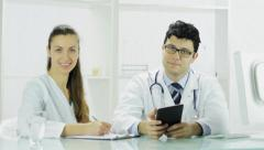 Two doctors using digital tablet medical reasearch Stock Footage