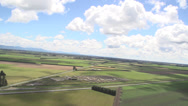 Stock Video Footage of Aerial Shot of blue sky and fields
