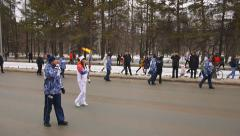 Young beautiful woman with torch of Sochi 2014 Winter olympic games Stock Footage