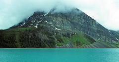 Glacial lake and peak in fog Stock Photos