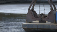 Stock Video Footage of Construction claw on barge in winter