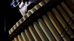 Panflute playing in studio Stock Footage