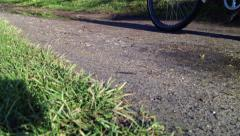 Tandem bike goes past on canal path - stock footage