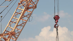 Construction crane lifting cargo Stock Footage