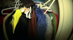 Coats in closet Stock Footage