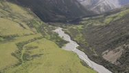 Stock Video Footage of Aerial shot of a stream and a mountain