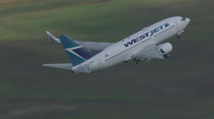 Boeing 737 Airplane Takeoff from the Air Stock Footage