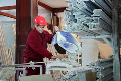Worker Cutting Pvc Profile With Circular Waw - stock photo