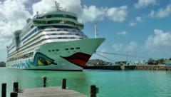 Antigua st. john's 140, pan over the pier in harbor to cruise ship aida luna Stock Footage