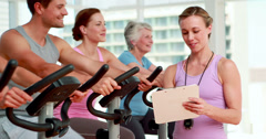 Happy group doing a spinning class Stock Footage