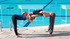 Couple near the pool, couple yoga Stock Footage