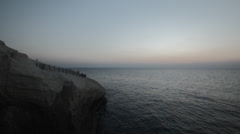 Sunset at Rosh Hanikra grottoes - south rock after sunset Stock Footage