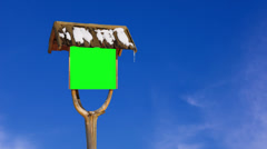 Old wooden sign road sign with snow on the roof Stock Footage