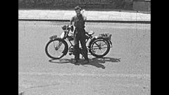 London 1948: man riding a motorbike in the street - stock footage