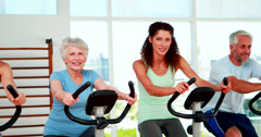 Happy diverse fitness group doing a spinning class Stock Footage