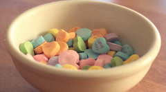 Kid Taking Valentine's Candy out of Bowl Stock Footage