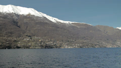 Across Lake Como Snow Peaked Mountains in background Stock Footage