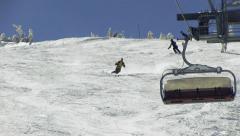 Skier skiing short swings Stock Footage