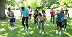 Boot camp class jogging on the spot Stock Footage
