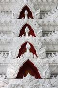 White stucco decoration in thai temple wall Stock Photos