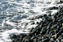 beautiful black pebble with smooth wave, koh lipe, andaman sea, thailand - stock photo