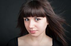 Studio portrait of a girl in black - stock photo