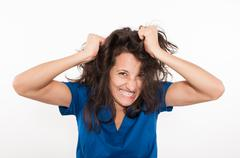 Stressed and frustrated young medical doctor pulling her hair Stock Photos