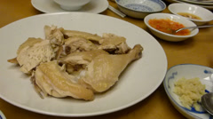 HAINANESE CHICKEN SERVED WITH RICE, CHILLY, GINGER, SAUCE (CHICKEN RICE--1A Stock Footage
