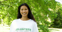 Pretty volunteer smiling at the camera Stock Footage