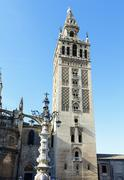 giralda tower, the belfry of the cathedral of sevilla - stock photo