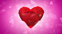 Heart made of rose petals loop, pink background Stock Footage