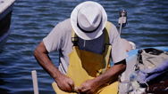 Stock Video Footage of Fisherman on his boat. Summer, blue sea.