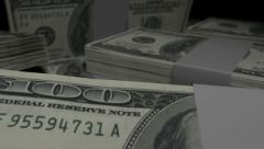 US dollar notes collection pile pan over dark Stock Footage