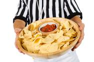 Stock Photo of referee: holding platter of chips and salsa