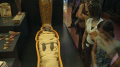 Two girls admire an Egyptian mummy kept in the Vatican Museums Stock Footage