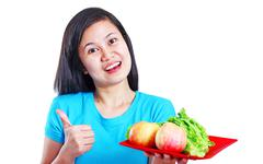 lady with fruits and vegetables - stock photo