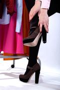Woman trying high heals Stock Photos