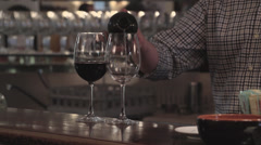 Barman pouring a glass of wine Stock Footage