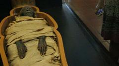 Egyptian mummy kept in the Vatican, tourist looks on Stock Footage