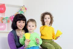 Stock Photo of mother with children celebrating birthday