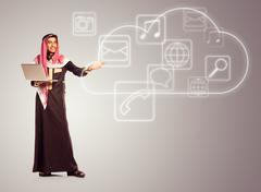 Young smiling arab with laptop shows virtual icons of the cloud service Stock Illustration