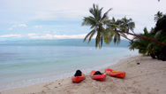 Stock Video Footage of Kayaks on tropical beach