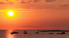 Golden orange sunset, bright hazy sun globe over the sea Stock Footage