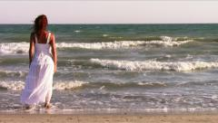A red-haired woman at the seaside Stock Footage