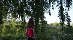 Woman hands blow long birch branches hang down Stock Footage