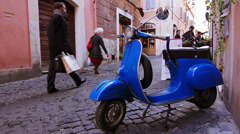 Vintage scene with Vespa on old street in Rome, Italy - stock footage
