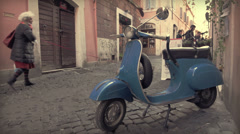 Blue vintage Vespa in old street in center of Rome, Campo de' fiori. Italy - stock footage