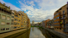 Timelapse footage of the colorful buildings on the Onyar River in Girona, Spain Stock Footage