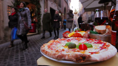 Typical street in Rome with pizza on foreground, Italy. Campo de' Fiori Stock Footage
